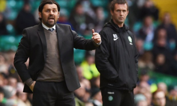 Dundee manager Paul Hartley, with Ronny Deila in the background.