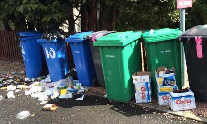 Litter left around bins on Kinnessburn Terrace has been branded 'a disgrace'.