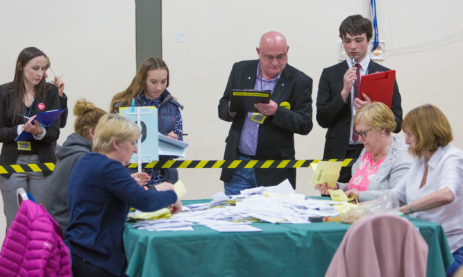 Counting for the Dunfermline & West Fife constituency takes place under the stare of party members.