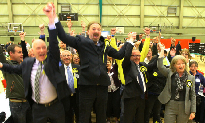Chris Law jumps for joy as his victory is confirmed.