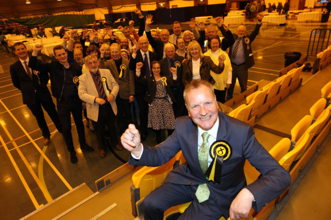 Pete Wishart and his team celebrate victory.