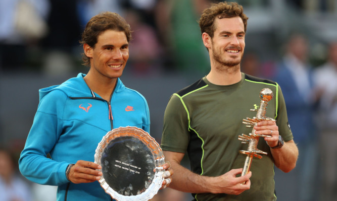 Andy Murray poses with his winner's trophy after his straight sets victory against Rafael Nadal.