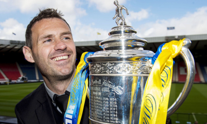 David McCracken admires the William Hill Scottish Cup.