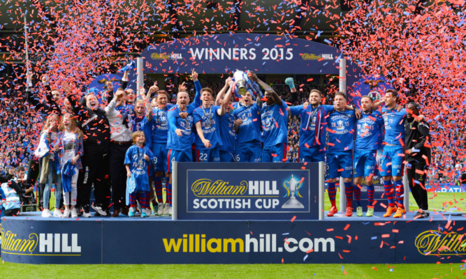 The Inverness players celebrate.