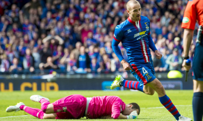 Inverness CT's James Vincent celebrates his winning.
