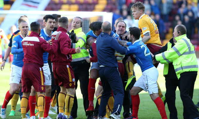 Rangers player Bilel Mohsni involved in a scuffle with Motherwell Lee Erwin (right) at full time.