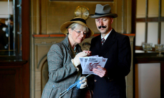 Best selling crime authors Christopher Brookmyre and Alex Gray get into character as Poirot and Miss Marple.