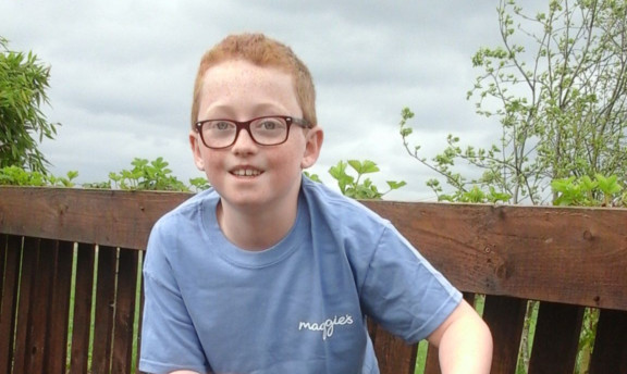 Quinn aims to cycle 65 miles with his dad for Maggies.