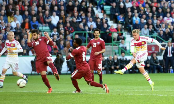 Scotland star Matt Richie (right) smashes home the opener.