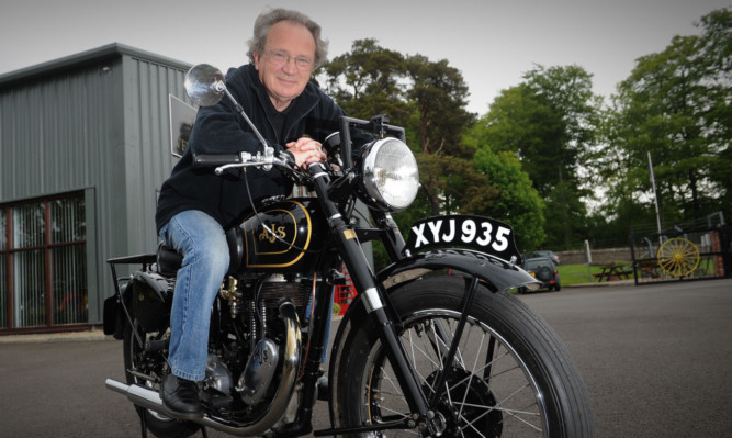 Revved up and ready to go: Stan with his 67-year-old AJS Model 18.