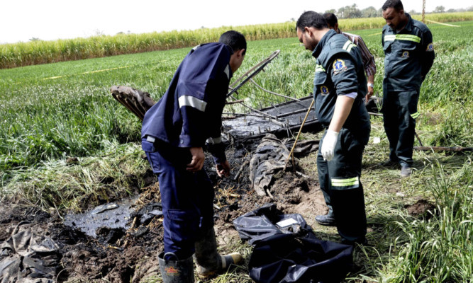 Egyptian rescue workers at the crash scene on 2013.