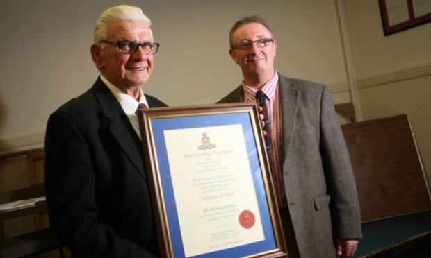 Tony Edney, left, who was instrumental in the conception and formation of the Tayside branch, receives his certificate of merit from Major Dave Findlay.