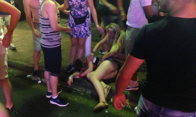 Tourists on the Punta Ballena strip in Magaluf after a night out in the town.