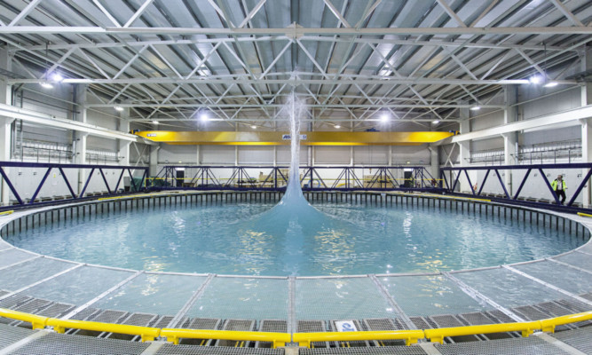 The FloWave Ocean Energy Research Facility features a testing tank that can recreate various sea conditions that wave energy machines will have to be able to withstand in a real-life situation.