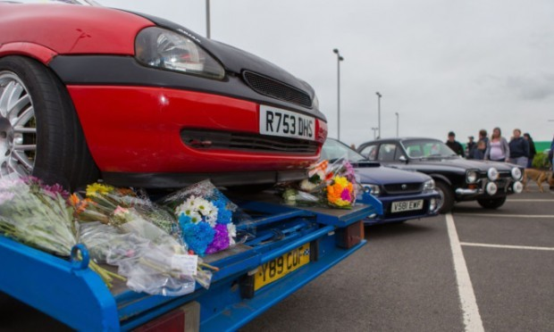 Flowers were laid on the car Brian Phimister was working on before his death.