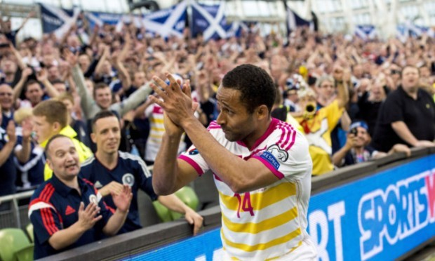 Ikechi Anya applauds the Tartan Army at the end of Saturdays game in Dublin.
