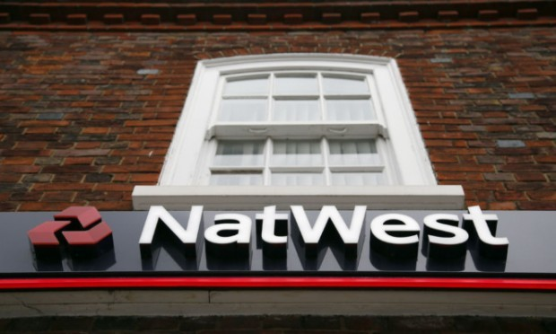 A National Westminster Bank branch (NatWest) logo in Beaconsfield, Buckinghamshire. ... Banks - stock ... 04-09-2014 ... Beaconsfield ... UK ... Photo credit should read: Jonathan Brady/Unique Reference No. 20815027 ... Picture date: Thursday September 4, 2014. Photo credit should read: Jonathan Brady/PA