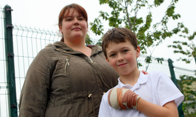 Kieran and his mother Gillian face an anxious wait over the damage to his hand.