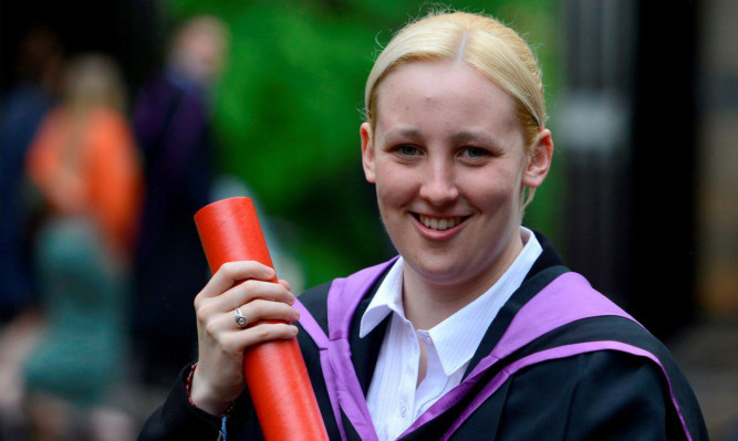 Mhairi Black with her degree scroll.
