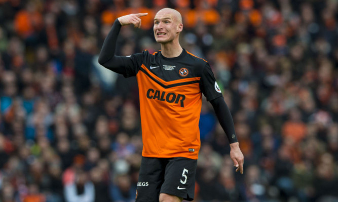 Jaroslaw Fojut in action for Dundee United.