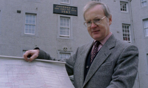 Graham Mackenzie, clerk of the trustees, holds one of the Cairnie family trees.