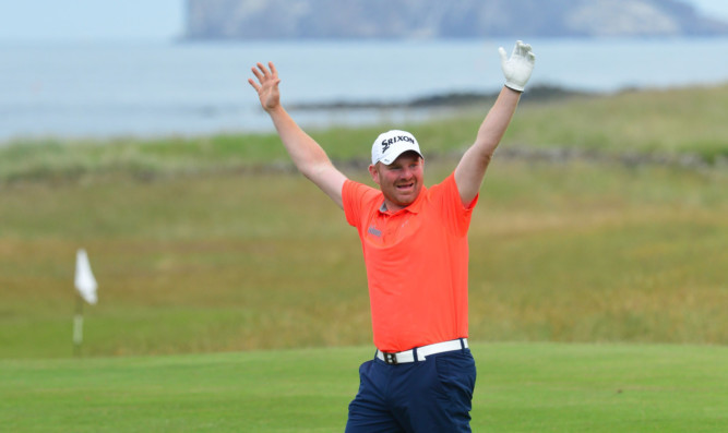 Gareth Wright celebrates his hole in one on his way to qualifying for the Scottish Open.