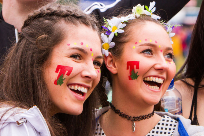 A damp start failed to spoil the party atmosphere on the first day proper of T in the Park 2015. Crowds were in high spirits on Friday as they explored the new site at Strathallan and looked forward to a weekend of music.