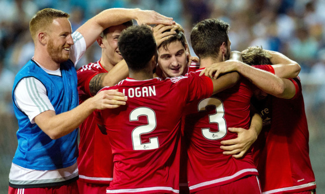 Aberdeen's Kenny McLean celebrates after giving his side the three goal lead.
