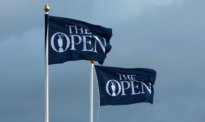 A view of flags blowing as high winds suspend play during day three of The Open Championship 2015 at St Andrews, Fife. PRESS ASSOCIATION Photo. Picture date: Saturday July 19, 2015. See PA story GOLF Open. Photo credit should read: David Davies/PA Wire. RESTRICTIONS: Editorial use only - no commercial use. No onward sale. Still image use only. The Open Championship logo and clear link to The Open website (www.TheOpen.com) to be included on website publishing. Call +44 (0)1158 447447 for further info.