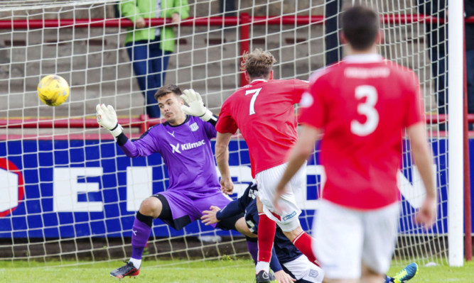 Brechin's Robert Thomson scores the only goal of the game.