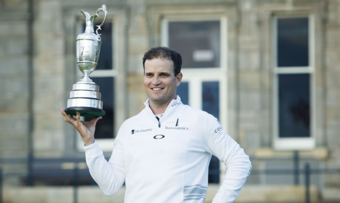 Zach Johnson celebrates with the Claret Jug after winning The Open Championship at St Andrews.