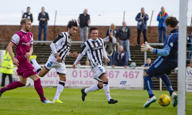 Two-goal Faissall El-Bakhtaoui heads home Dunfermlines third past Lichties keeper Allan Fleming as they cruised into the second round.
