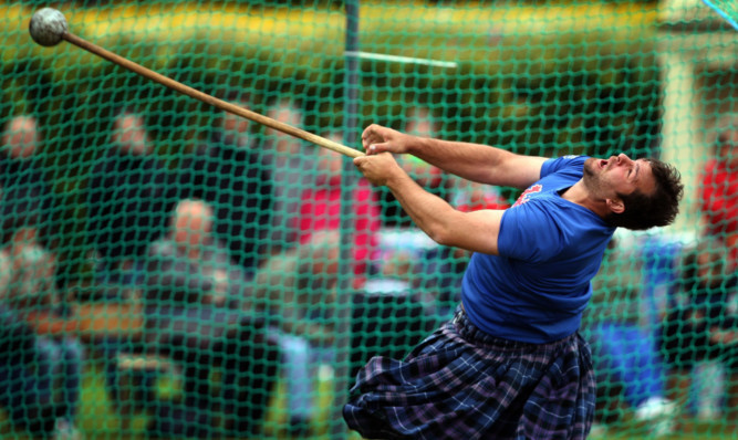One of the heavies competes in the hammer at the Fife games.
