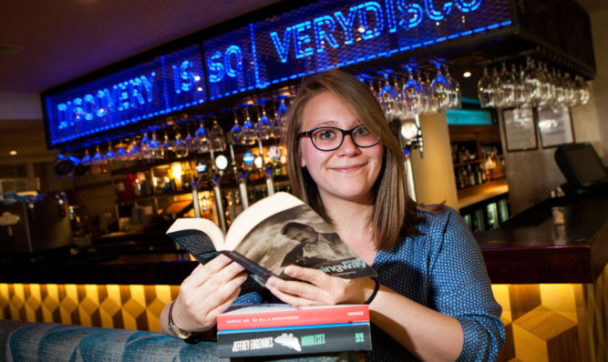 Mariel Symeonidou reads in the South Tay Superstore pub in Dundee.