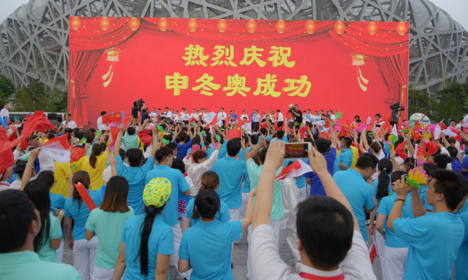 People celebrate at Olympic Plaza as Beijing wins the bidding of 2022 Olympic Winter Games.
