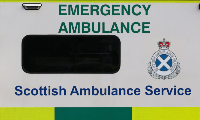 Scotland's First Minister Nicola Sturgeon, with emergency services paramedic Richard Lyell, as she leaves an ambulance in Edinburgh after she thanked them ahead of the festive period.