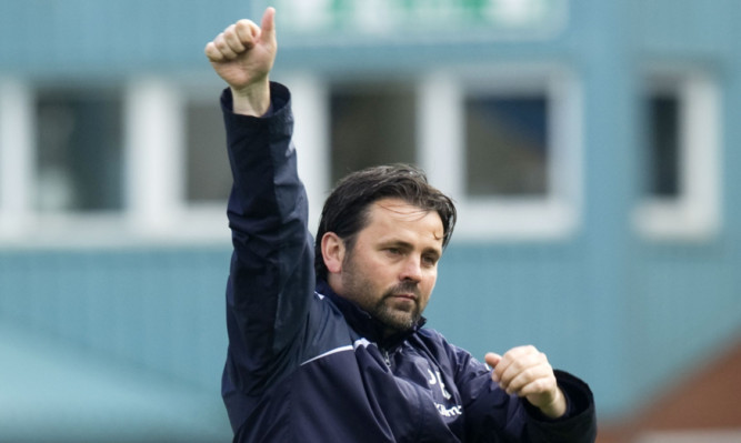 Thumbs up from Paul Hartley at the final whistle.