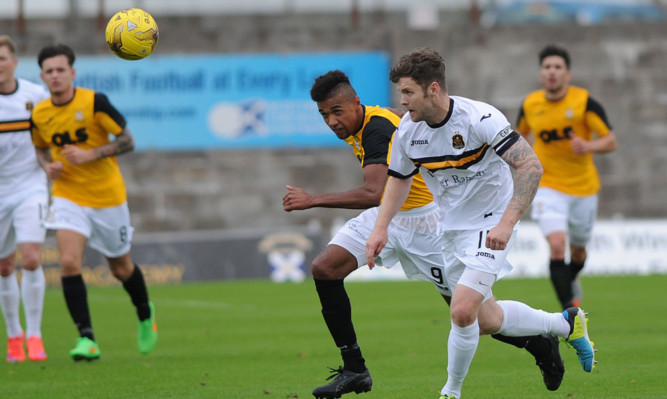 Nathan Austin chases down Sons defender Darren Barr.