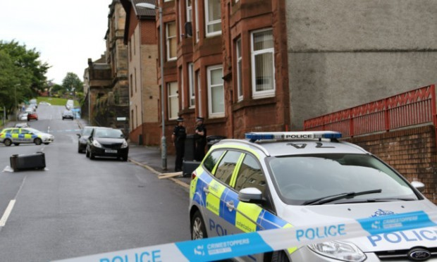 The man was found seriously injured in the street in Greenock.
