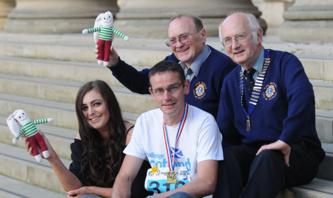 From left: Hannah Clark, fundraising and events assistant for the ARCHIE Foundation, club members David Kydd and Dick Lawson and club president Tom McDade.