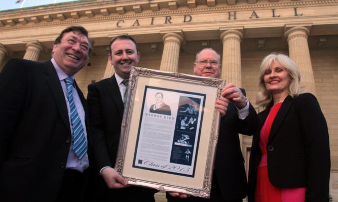 Councillor Len Ironside, wrestling historian Bradley Craig, Lord Provost Bob Duncan and Caird Hall manager Susan Gillan with the plaque to honour George Kidd.