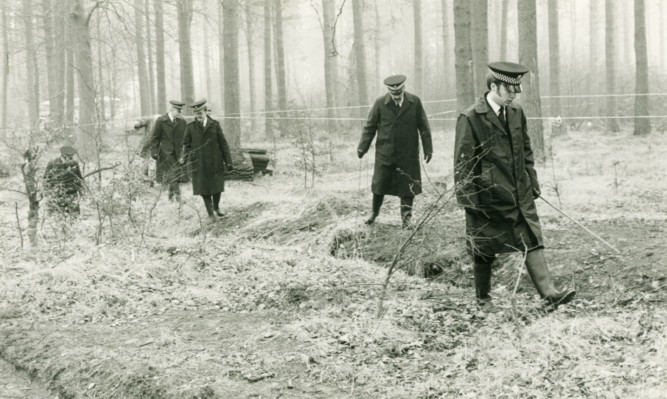 Police search Templeton Woods in 1980 following the discoveries of the bodies of Carol Lannen and Elizabeth McCabe.