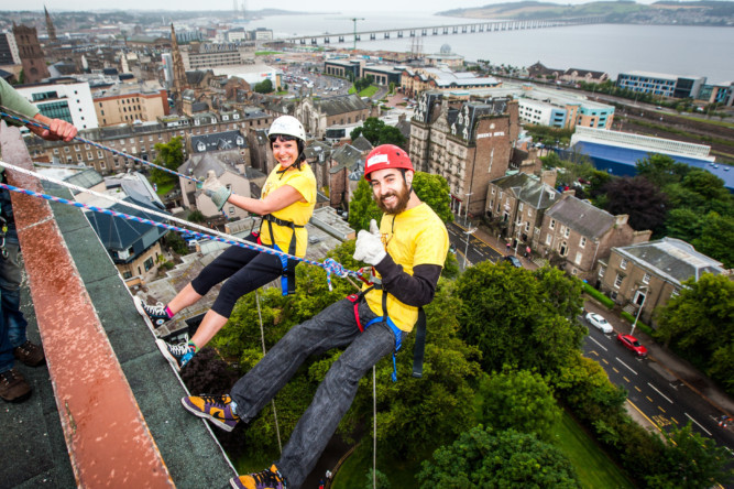 A group of six intrepid people abseiled down Dundee Universitys tower building to raise money for the ARCHIE foundation at the weekend. Two members of the foundation accompanied four nurses in completing the feat to help to raise money to build a new operating theatre for children at Ninewells.  Photo shows Suzanne Scott and AJ McMenemy taking the plunge.