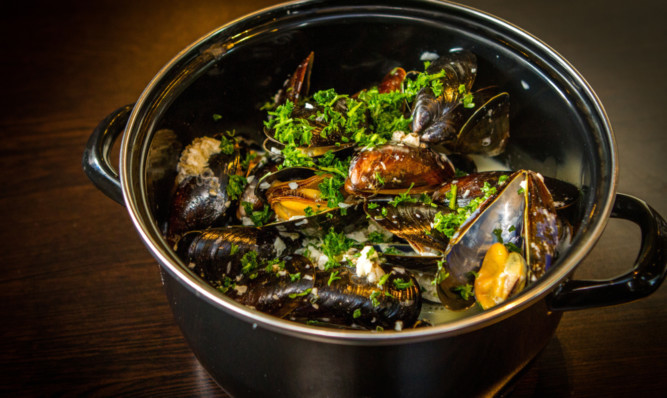 Steamed mussels with white wine and shallots.