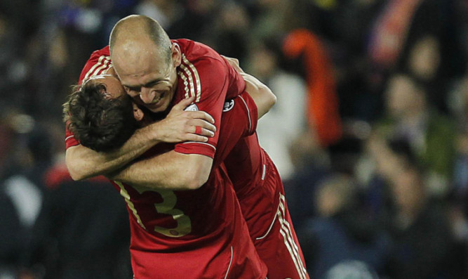 Bayern's Rafinha and Arjen Robben celebrate after winning the Champions League semi-final.