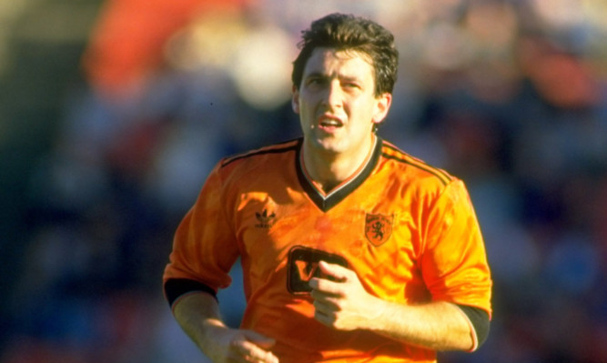 Ralph Milne of Dundee United in action during a Scottish Premier Division match against Aberdeen at Pittodrie Stadium in 1985.
