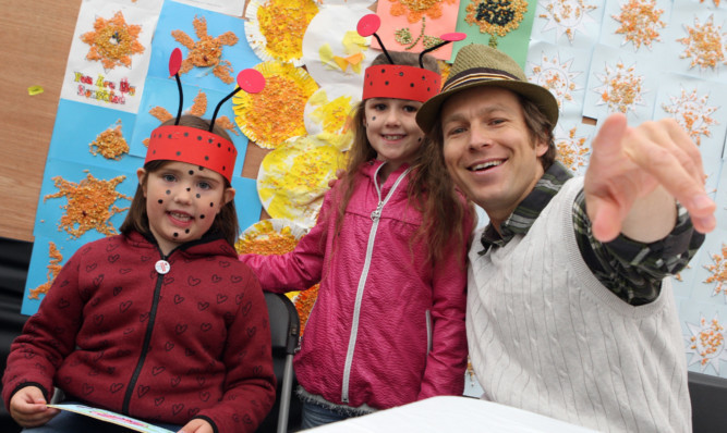 Morven Tasker and Summer Stephen with BBCs Mr Bloom, an attraction for some of the younger visitors to the festival.