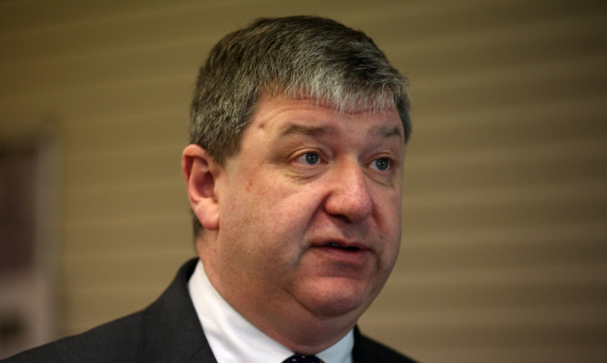 Alistair Carmichael is facing a legal challenge to oust him as MP by four constituents.