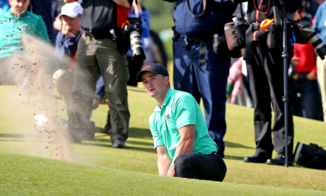 Paul Dunne plays out a bunker during GB&I's record Walker Cup game.