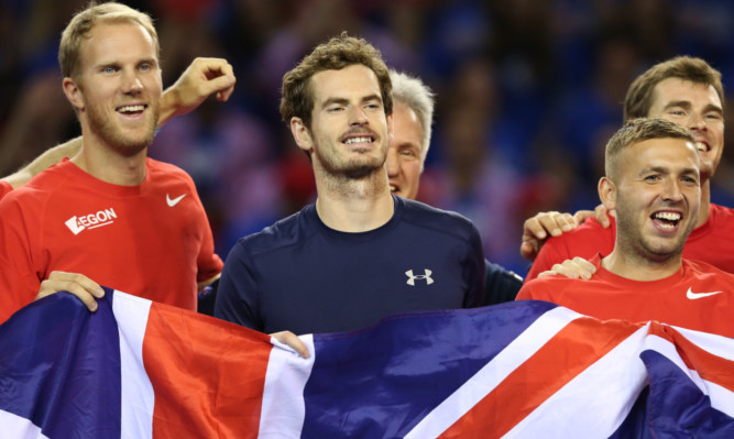 Andy Murray celebrates with his team-mates.